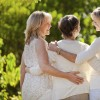 three women with their arms around each other
