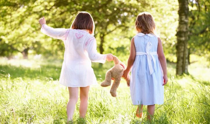 2 Young Girls Walking Through Summer Field Carrying Teddy Bear