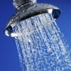 Close up of water flowing from chrome shower head