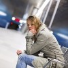 young woman sitting in metro station