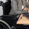woman in wheelchair at desk