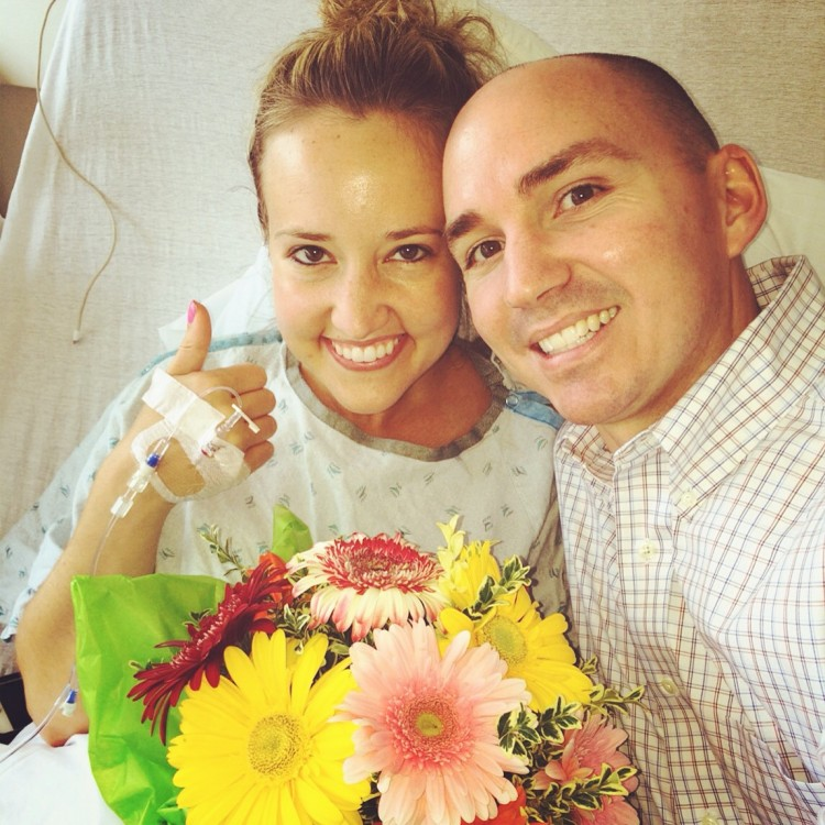 man and woman in hospital bed with flowers