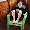 young boy sitting in green chair