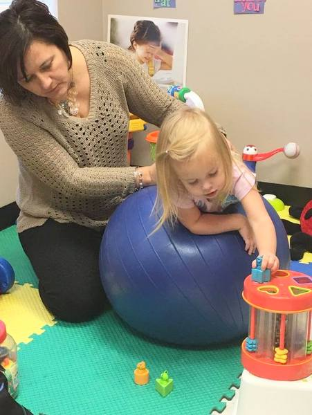 Ali Cummins's daughter during a therapy session.