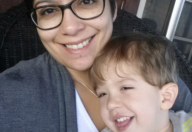 woman wearing glasses and toddler boy