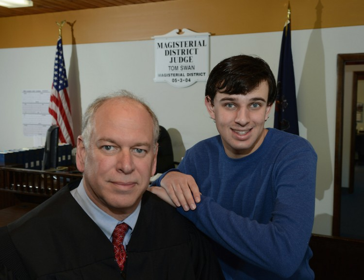 District judge Tom Swan and his autistic 19-year-old son, Kevin, inside the courtroom of his West Deer magistrate's office on Friday, Feb. 12, 2016.