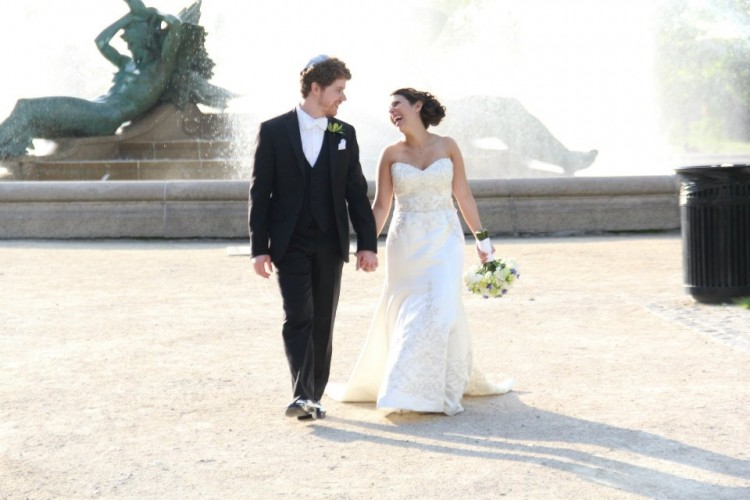 couple on wedding day in front of fountain