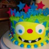 cake decorated to look like henry hugglemonster cartoon
