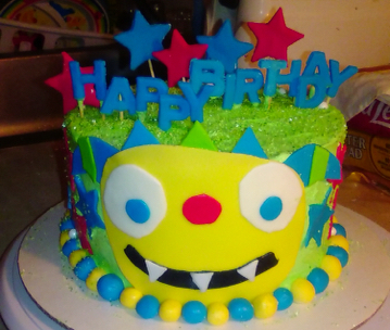 cake decorated to look like henry hugglemonster cartoon