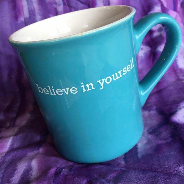 blue coffee mug with believe in yourself written in white
