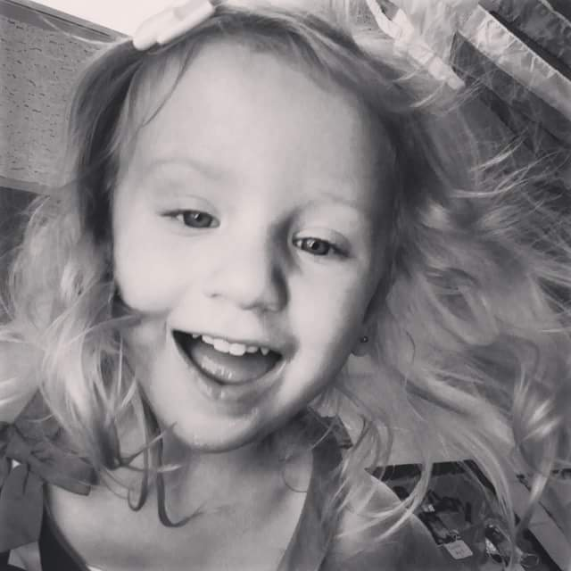 daughter smiling, black and white photo
