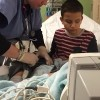 boy being treated in hospital bed