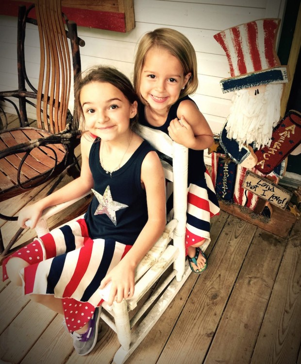 two girls searing red white and blue outfits