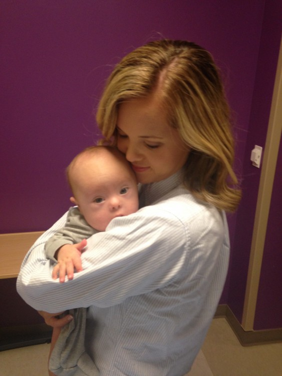 woman holding newborn baby