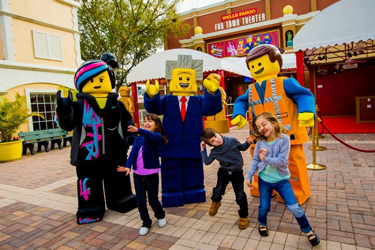 A trio of children play with Lego characters at the Legoland Florida park in Winter Haven, Florida