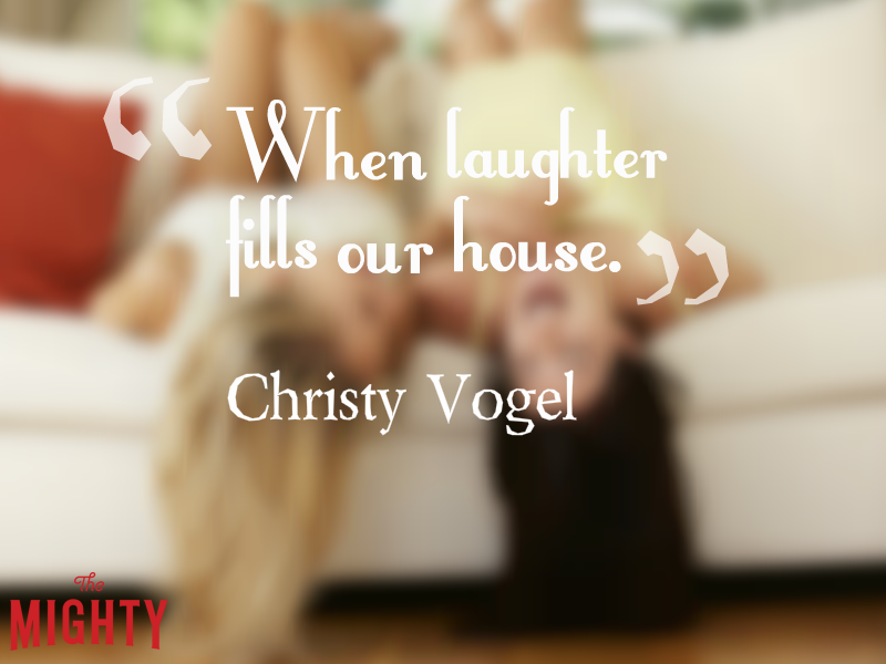 "Two woman sitting on the couch upside down, laughing, with the text: ""When laughter fills our house."""