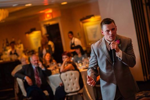 Man giving a speech, wearing a suit