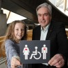 Iain Gray MSP and 10 year old Grace Warnock, a school pupil from Prestonpans in East Lothian, unveil a new disabled toilet signs, designed by Grace, which is now in place at the Scottish Parliament's accessible toilets.