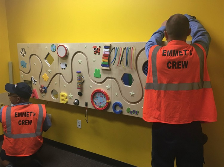 Workers at Legoland Florida build a sensory panel for children on the autism spectrum. This is just one of the many improvements they're making to the park as part of their partnership with Autism Speaks.