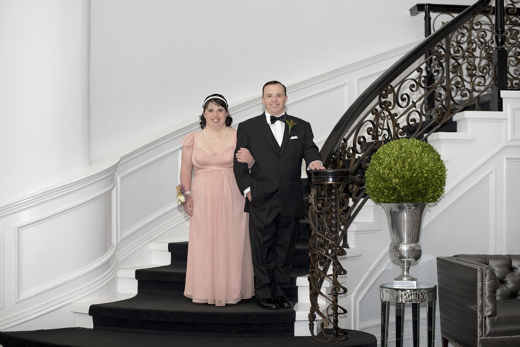 young woman and man standing on stairs