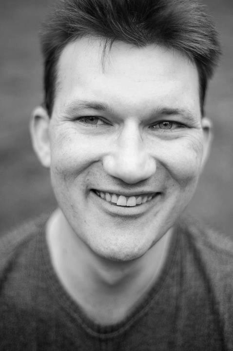 man smiling, black and white photo