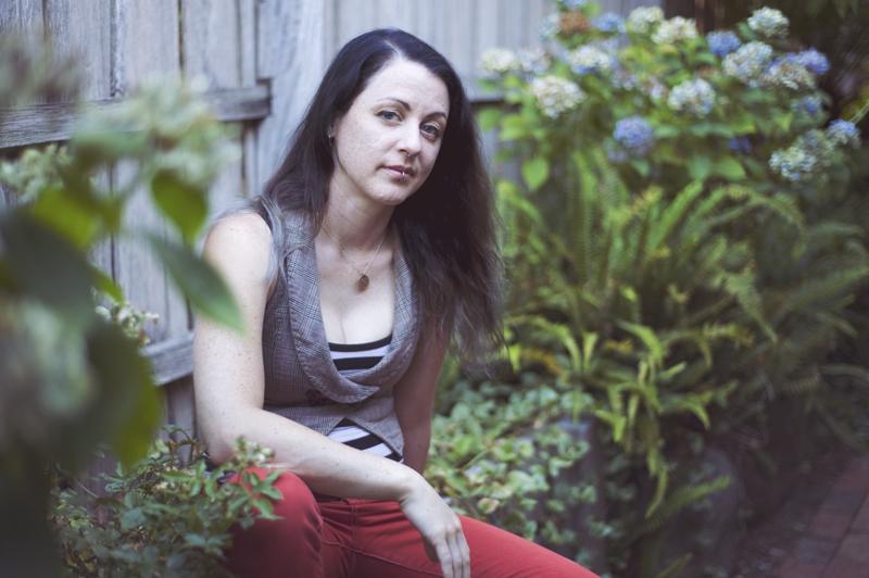 person sitting in garden