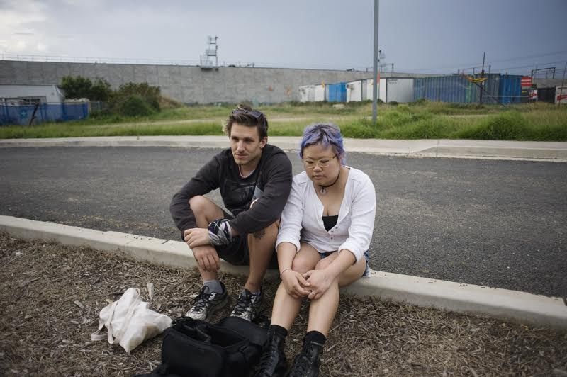 Glaser and Phoon sit on sidewalk