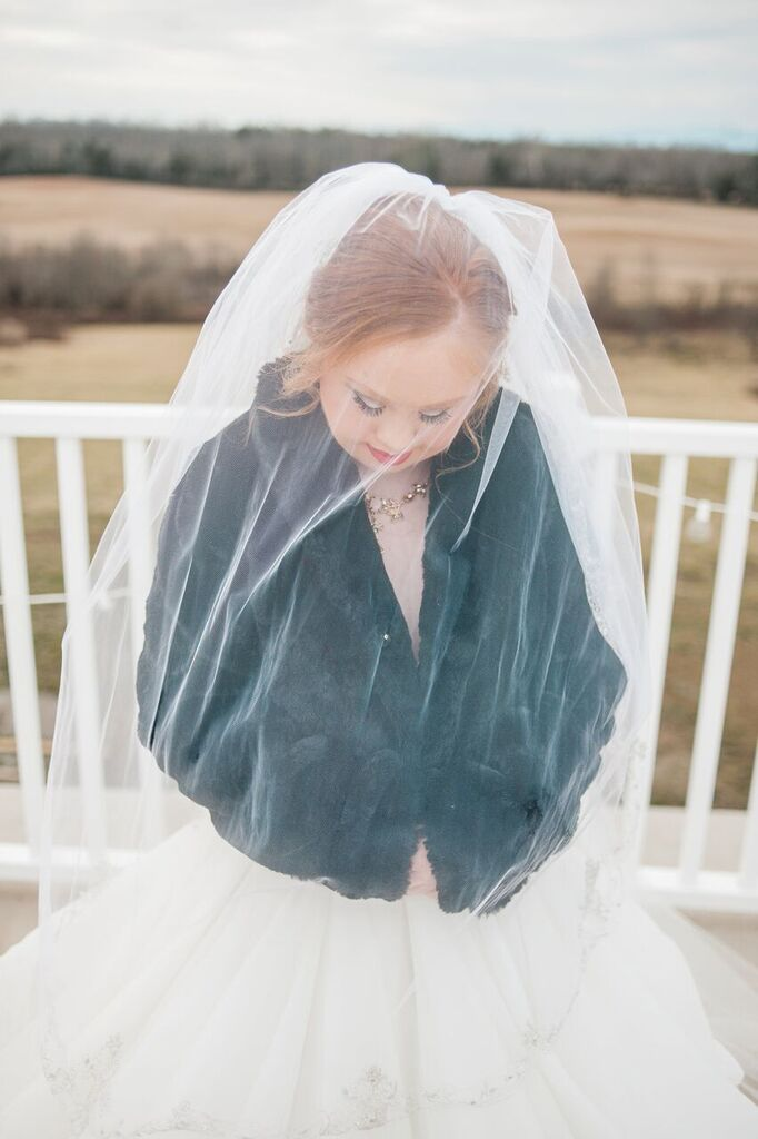 madeline stuart with black jacket over dress