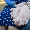 Close up a couple holding hands. The woman r