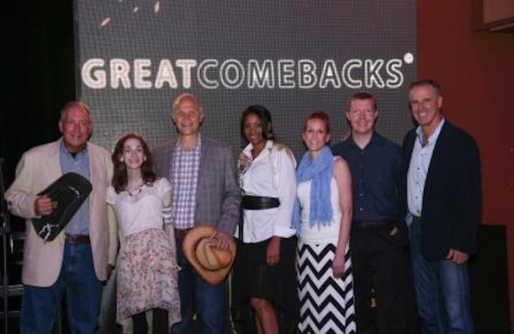 group of people posing in front of sign for great comebacks awards