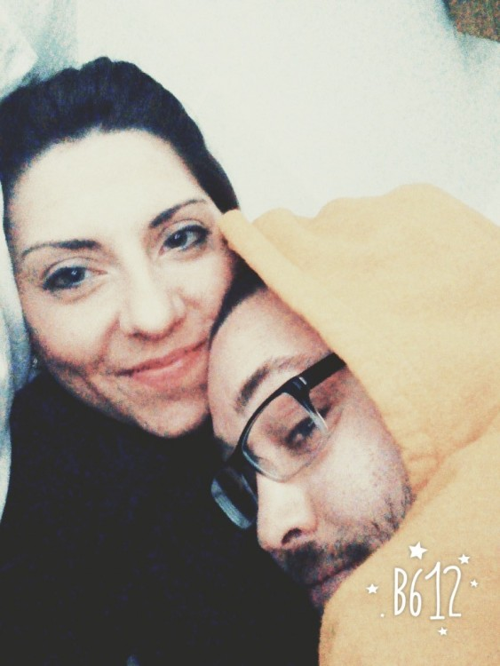 woman and man wearing glasses and a hooded sweatshirt