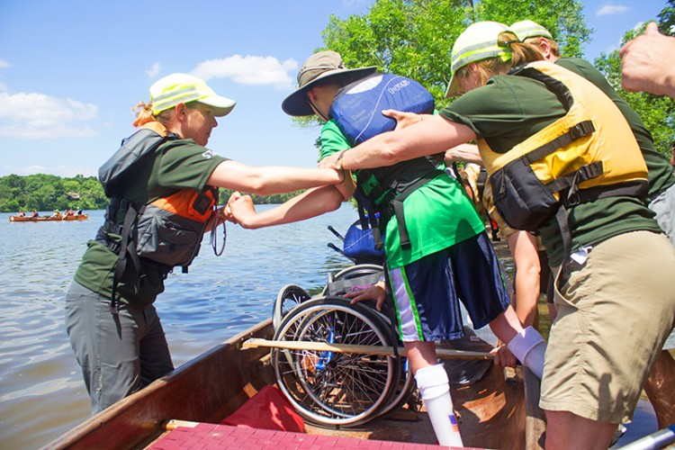 A person with a disability gets into a canoe