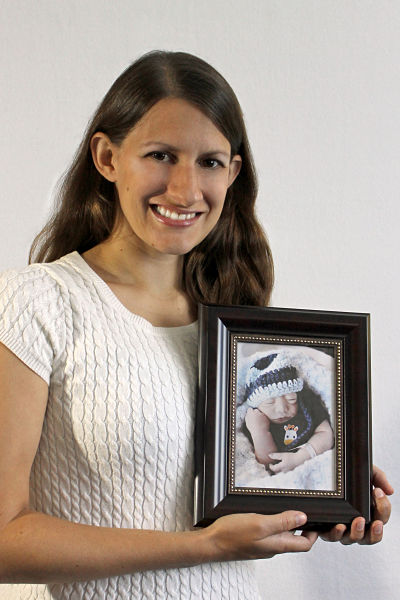 Bethany Conkel with a photo of her son.