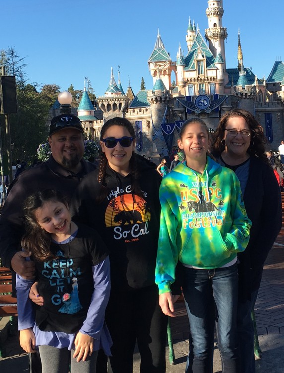 The Cota family -- mother, father, two daughters and their friend -- at Disneyland