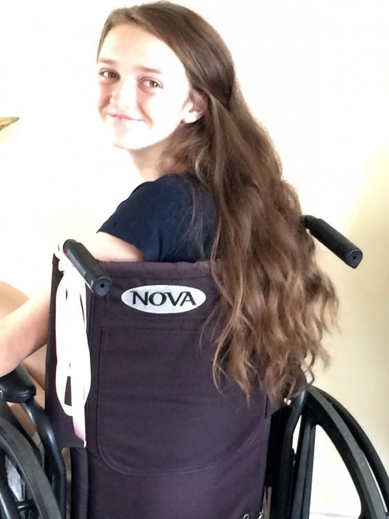 Elizabeth - teenage girl using a wheelchair.