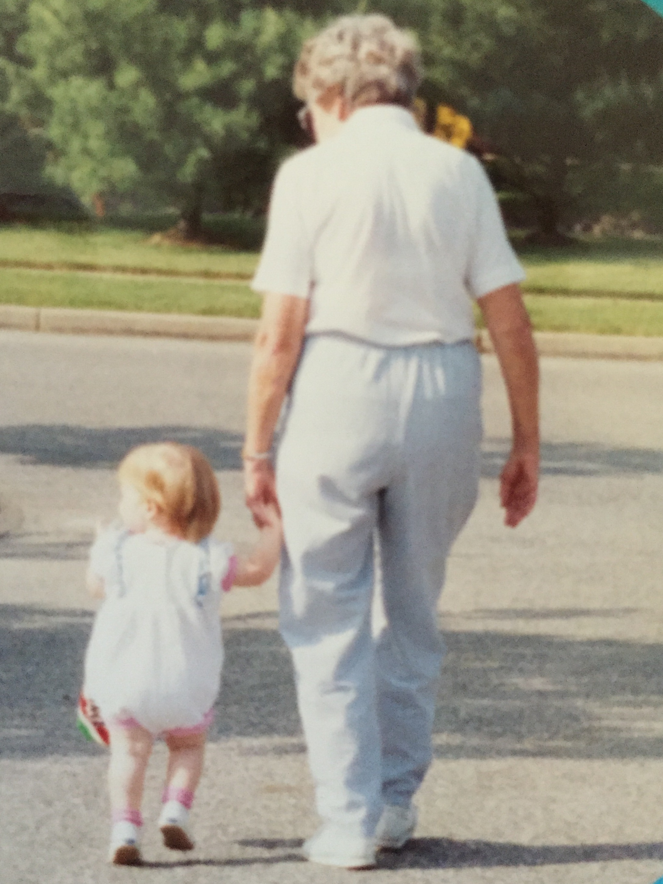 megan as a baby, walking with her nana