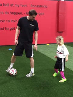 little girl at soccer practice with her coach