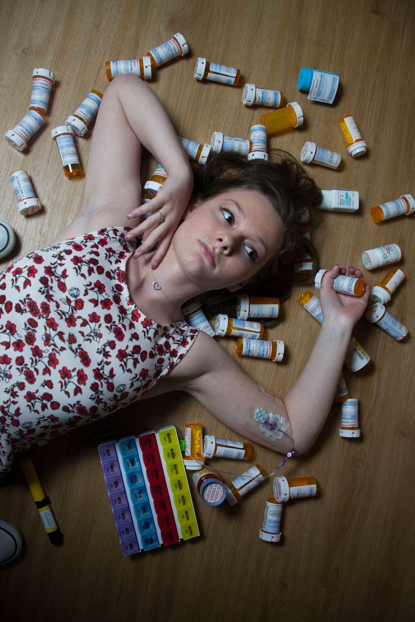 hailey laying on top of pill bottles