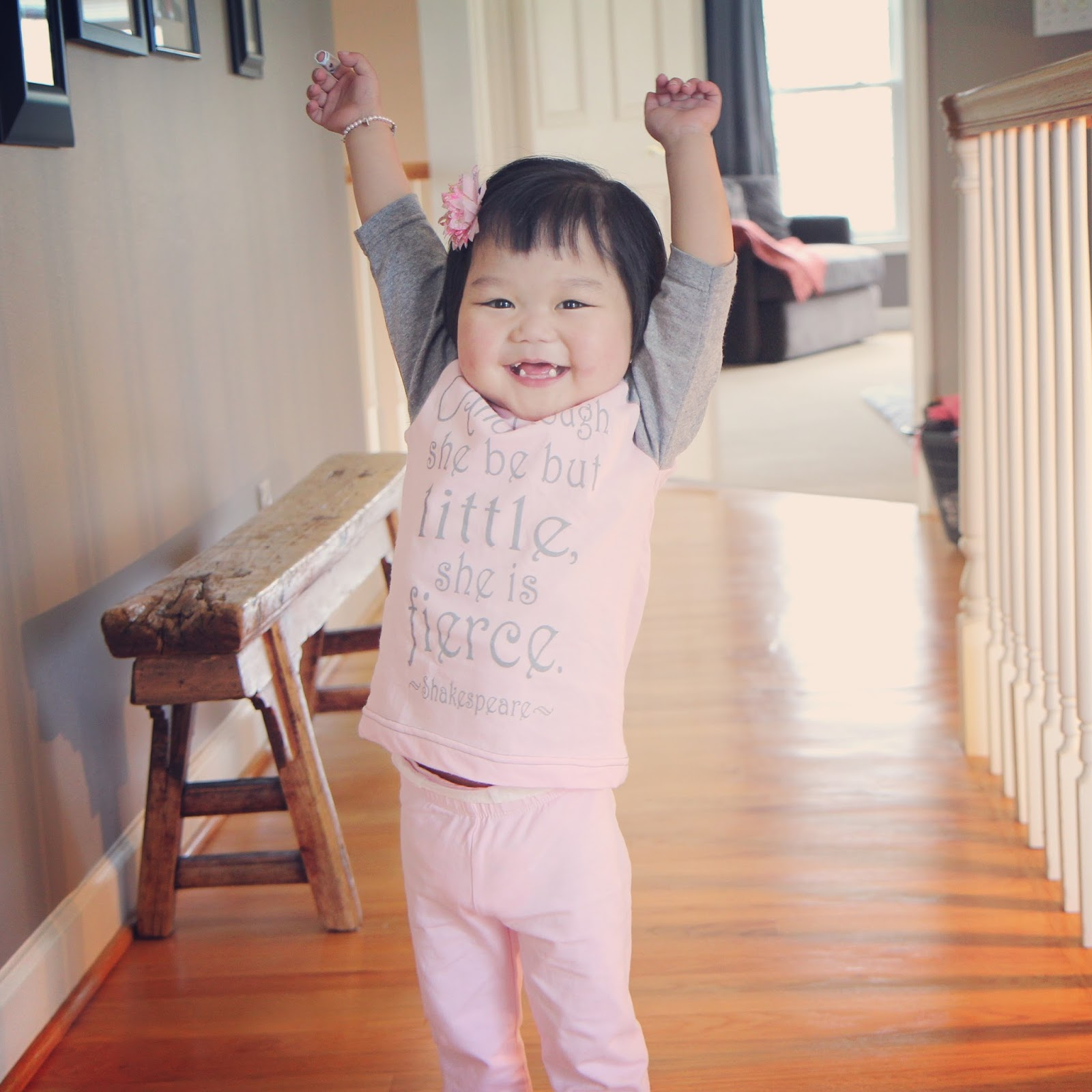 author's daughter with arms up