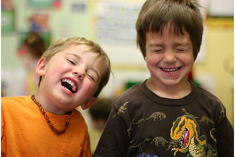 two young boys laughing together