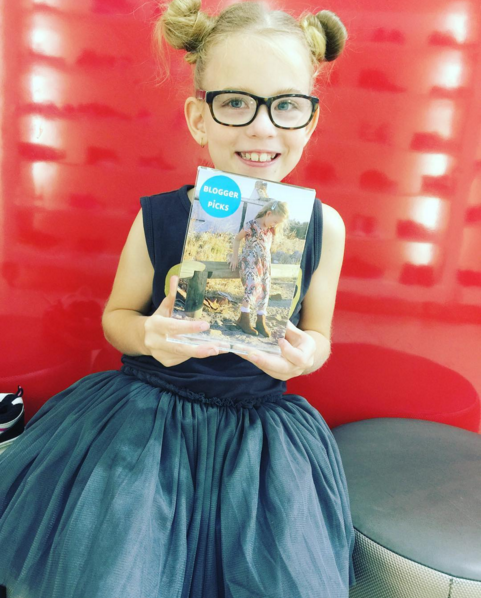 emily holding up magazine with her on it