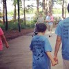 two brothers holding hands with autism shirts on
