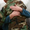 woman hugs army man
