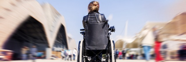 young lady in a wheelchair looking for a destination