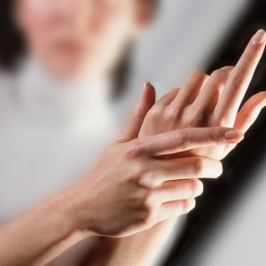 a close up of a woman rubbing her hands
