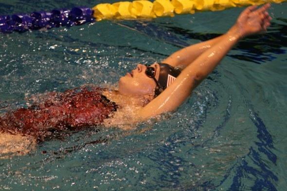 Beth swimming the backstroke.