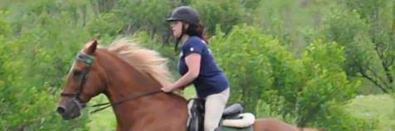 Amanda riding her horse.