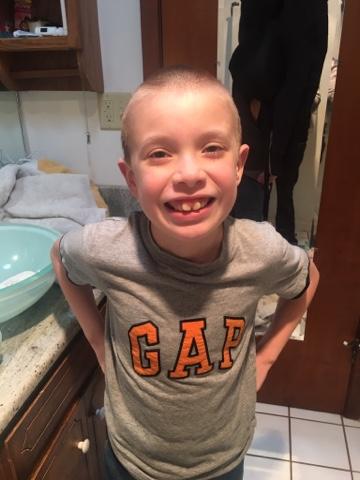 young boy in grey gap shirt
