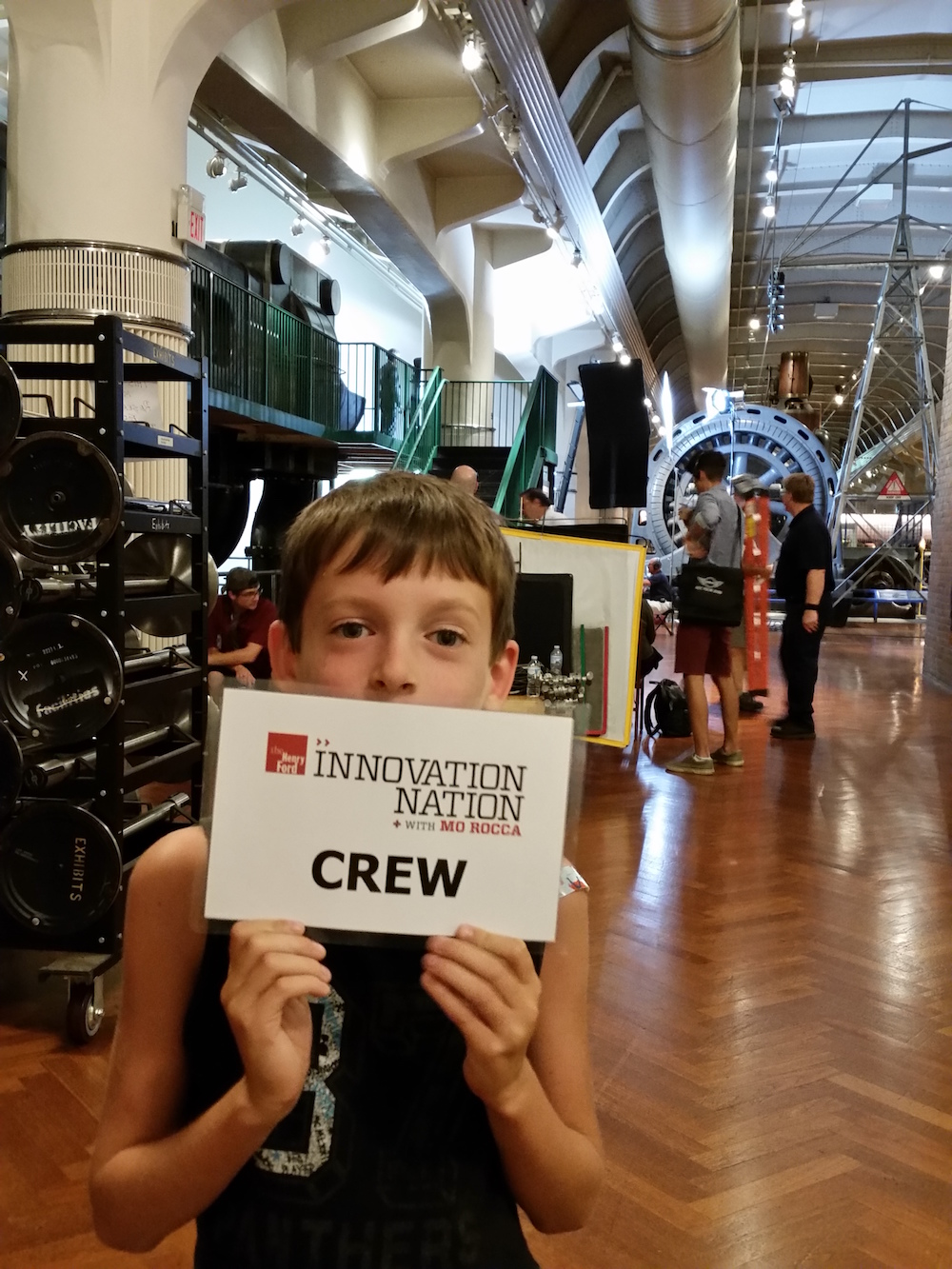 son holding crew card from Jim Lichtenstein