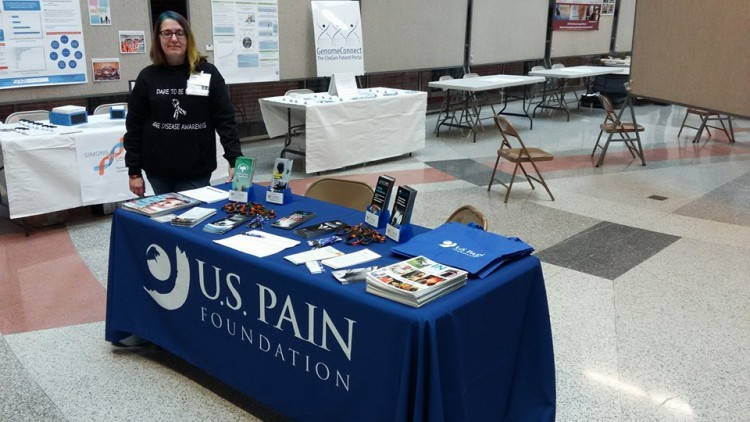 woman standing next to table for US Pain Foundation